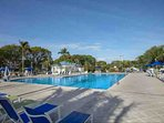Huge, newly renovated pool and deck with new lounge furniture, pool bar and umbrella tables for dining
