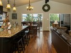 Wide open living area with vaulted ceilings