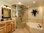 Enjoy a relaxing soak in the jacuzzi tub or steam shower (Master BA)