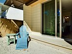 Step outside the master bedroom to relax on the adirondack chair.