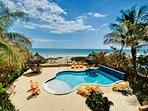 Spacious deck, tiki huts, beautiful heated pool and direct beach access!
