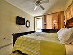 Flat scren TV for you to enjoy in the master bedroom.