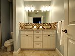 Upscale master bathroom with two sinks