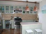 Range cooker, large fridge/freezer, wine fridge, dishwasher, Nutribullet, Microwave