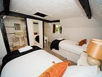 Horseshoe Cottage set up as a twin. Our twin beds also have mattress toppers and 100% cortton sheets