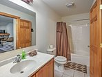 The bathroom on the first floor features a marvelous shower-tub combo!