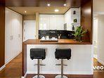 Kitchen with a breakfast bar and 2 stools.