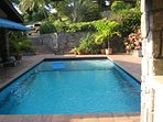 The property's large pool is the centerpiece of the outdoor area.