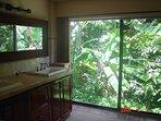 Master bathroom with duel vanity sinks, and large sliding balcony door.