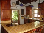 The spacious kitchen includes a 4 burner stove, oven, large fridge, micro-wave, ice maker, coffee maker, and Tea Pot.