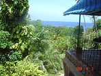 View of the Caribbean Sea from one of Woodland Estate's many outdoor seating areas, covered balconies, and vantage...