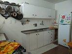 Kitchen. Large fridge, double sink.