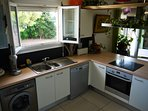 Kitchen with dish washer, electric oven, vitro ceramic hob and toaster.