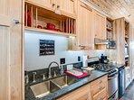 Full kitchen; granite counters, gas stove w/oven,under-counter fridge, coffee maker, hot pot, micro