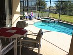 Pool area has outdoor furniture for a meal or relaxing in the sun!