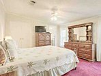 Master bedroom with queen bed and views of the water.
