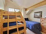 Guest bedroom 2 with separate twin bed and bunk with twin over double bed