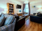 Huge Lounge with Plenty of Comfortable Seating, Sea Views and a 51' TV