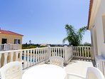 Balcony of 3 bed villa with sea views with table and charis accessible from 2nd bedroom of first flr