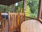 Buffet table with high chairs and hot tub. Facing the top peaks of Mt. Leconte'