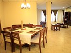 Gather around the lovely dining table to enjoy your meals.