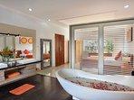 En-suite bathroom with private bathtub