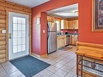 Tile floors and bright-colored walls greet you as you walk through the front door.