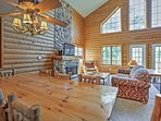 Gather around the large wooden dining table to enjoy your homecooked meals.