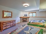 A fireplace, cable TV, and 2 Queen-sized Beds in one of the downstairs bedrooms guarantees warm, peaceful nights.