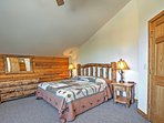 Catch up on some much-needed sleep in the Master Bedroom's King-sized Bed.