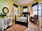 Queen size bed in guest bedroom.