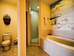 Separate lavatory, walk in shower, and large garden tub in master bathroom