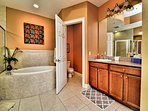 Master bathroom has private lavatory and his and hers vanities.