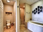 Garden tub and walk in shower in the master bathroom.