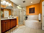 Master bathroom has walk in shower and jetted garden tub.