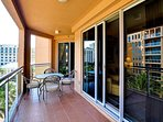 Long balcony attaches to living room and bedrooms