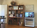 entertainment center with books, games, directv, Netflix, bluray player