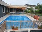 Vistas de la Terraza, piscina y jardín