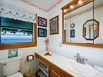 Master bathroom upstairs has tub/shower combo. Ocean views!