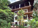 This multi level villa ha a gorgeous vantage point over the jungle.