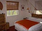 top floor master bedroom with a queen size bed