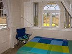 ocean view ground floor bedroom with a queen size bed