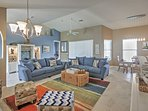 Lounge on the couches in the colorful living area.