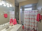 You'll feel fresh as a flamingo after showering off in this delightfully decorated bathroom.