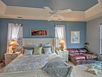 The heads of the household will catch up on some much needed sleep in this king-sized bed in the master bedroom.
