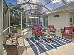 Kick back and relax in the many chairs on the screened-in patio.