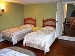 Twin beds with queen bed.