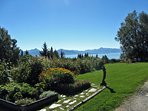Side yard garden, lawn, and fire pit overlooking Kachemak Bay
