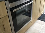 Neff slide and hide oven in the well stocked holiday home kitchen.