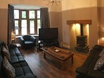 Lounge with log burner, reclining seats, sound surround DVD, Plasma TV, Freeview & BT Sport and Wii